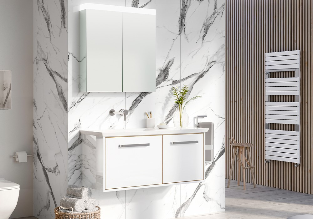 Modern White Bathroom | For a luxury white bathroom, consider introducing white basin mixers to perfectly complement white basins and furniture for a relaxing look.
