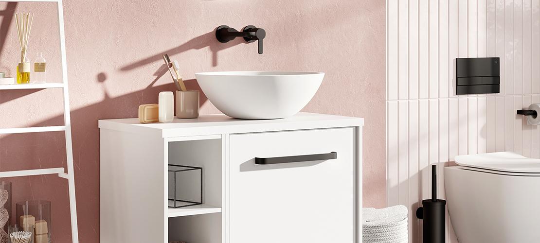 Matt black taps, white vanity unit and countertop basin