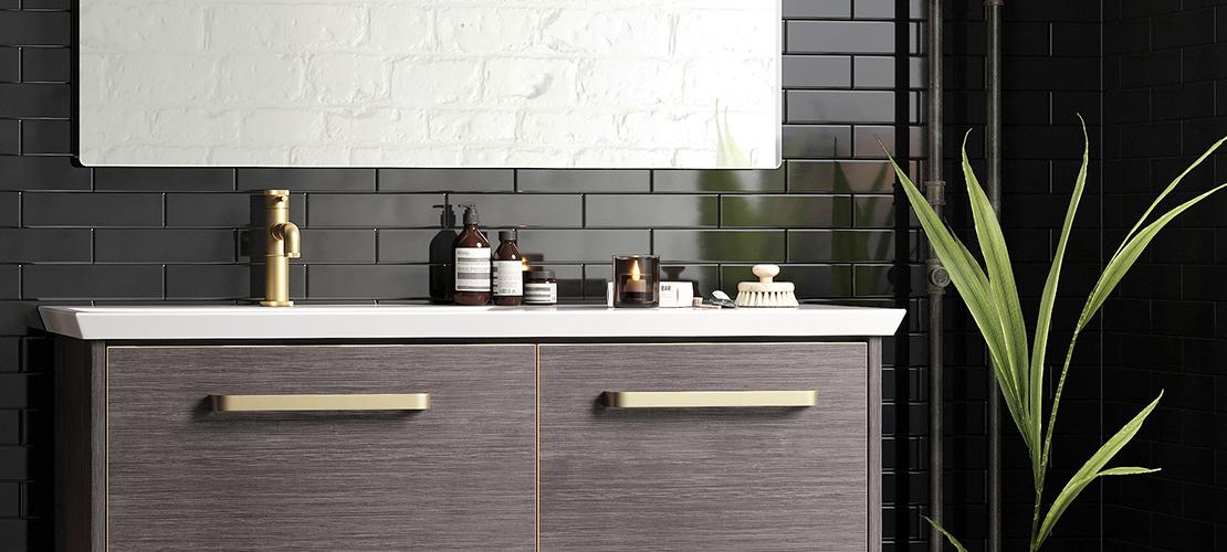 Brush brass monobloc taps, industrial bathroom design